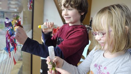 Oliver, eight, and Lizzy Sceats, six, work on a window mosaic to create a water effect at firstsite'