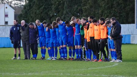 Ipswich Wanderers' players take part in a minute's silence for Roger Wosahlo on Saturday. Photo: ADR