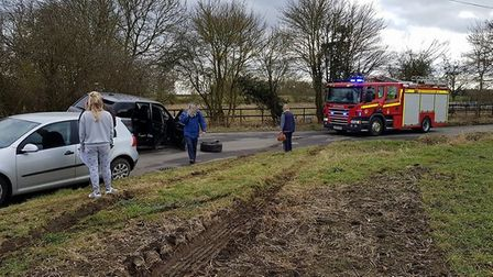 A road is closed in the south Norfolk village of Burston as fire crews attend an incident. Photo: Ma