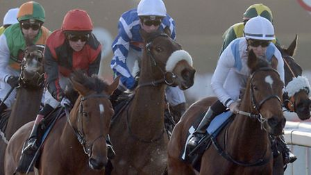 Zamoura ridden by Nicky Mackay (right) goes on to win the SIS Fillies' Stakes