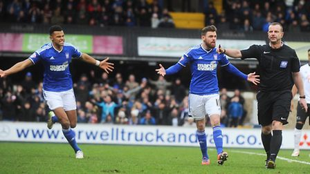 Tyrone Mings (left) and Paul Anderson urge referee Kevin Wright to award a penalty after Jay Tabb's
