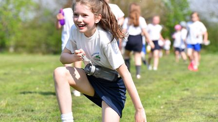 Yougsters from Palgrave Primary School take part in a mini marathon around the village sports field