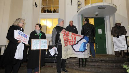 Minister Norman Lamb speaking at the public meeting in Saxmundham. Protestors outside the meeting.