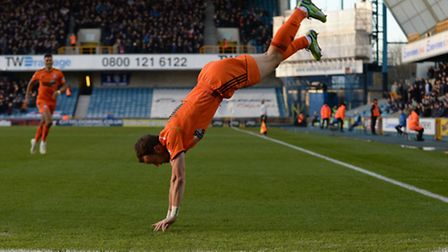Noel Hunt launches into an acrobatic celebration after scoring Ipswich's goal first at Millwall