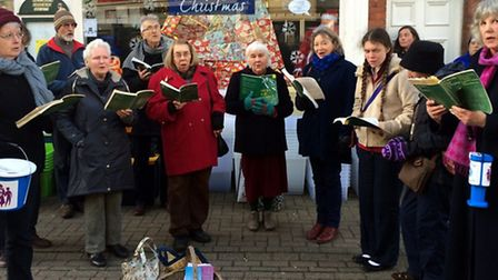 The All Saints Singers of Laxfield singing to raise funds for Halesworth Community Nursing Care Fund