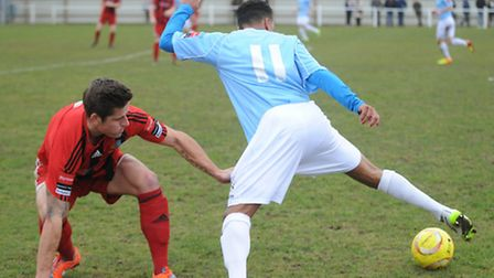 Needham's Rhys Henry (blue) gets away from Brighlingsea's Ricky Griggs