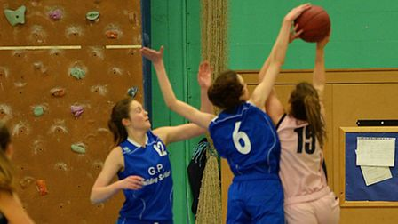 Maya Price of Ipswich U16 girls, blocks a Southend shooter, one of 6 blocks she made in the game