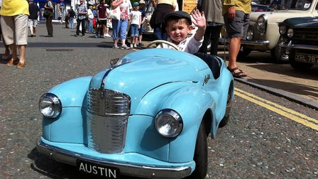 The Diss Heritage Transport Fayre. Joshua Vincent, three, in his model Austin J40.