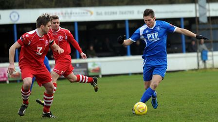 John Sands (blue) in action for Bury Town against Leiston