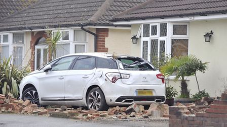 A car crashed into a wall in front of a house on Foxhall Road last night.