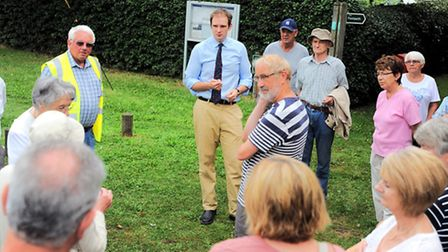 Dan Poulter MP talking to residents from Rushmere St Andrew last year after the complained about flo