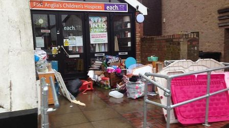 A large amount of items were dumped outside the EACH charity shop in Diss and left to get damaged in