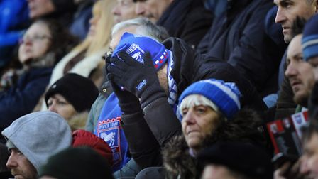 One Town fan cannot bear to watch the defeat at Rotherham.