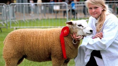 Charlotte Cobbald at the Suffolk Show with one of her winning Texel sheep.