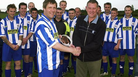 Garry Overton being presented with a trophy by club chairman, Terry Wilkinson, to mark his 450th gam