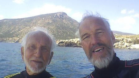 Ray Wooley, 94, (left), pictured with his son Ken, has been named in the Guinness Book of Records as