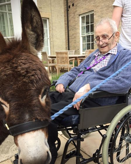 Oaklands resident Erik Reeve with a Donkey. Picture: Kingsley Healthcare