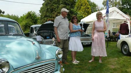 Bev Kembery, owner of The Burston Crown, presenting the award for her Car I would take away a Morri