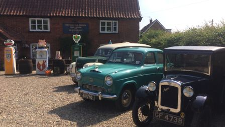 Classic cars and old petrol pumps outside The Burston Crown for East Anglian Practical Classic Car C