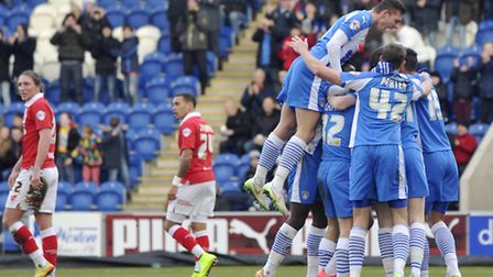 Colchester's Tom Lapslie celebrates his goal in the first few minutes of the match with teammate Mac
