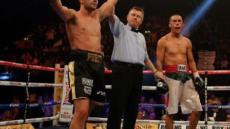 Great Britain's Lee Purdy (left) celebrates defeating Mexico's Cosme Rivera in their IBF Internation
