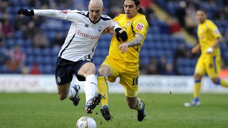 Richard Chaplow (left), pictured in action for Preston.