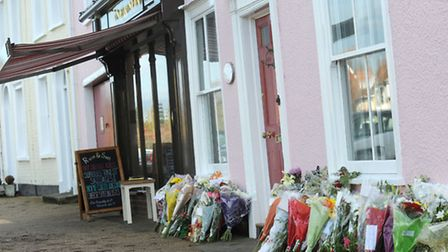 Floral tributes outside Ruse and Son Butchers in Long Melford.