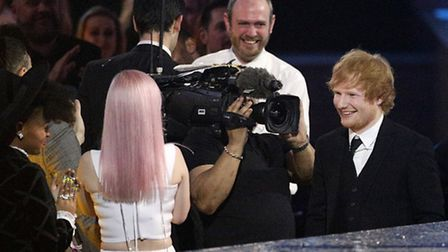 Ed Sheeran makes his way to the stage to collect his Best Male Solo Artist during the 2015 Brit Awar