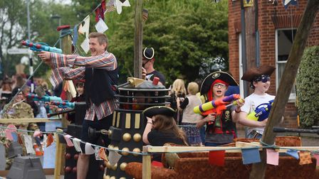 Pirates spray water on the watching crowds in the Diss Carnival parade. Picture: DENISE BRADLEY