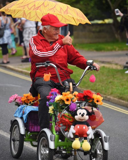 Pat Woods on his flower cycle in the Diss Carnival parade. Picture: DENISE BRADLEY