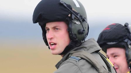 Prince William on the ground after he went flying while training at airbase RAF Cranwell, near Sleaf