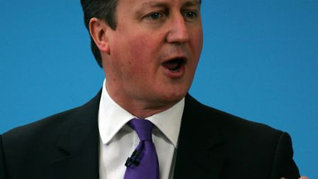 David Cameron has set out a policy which could see struggling schools turned into academies. Photogr