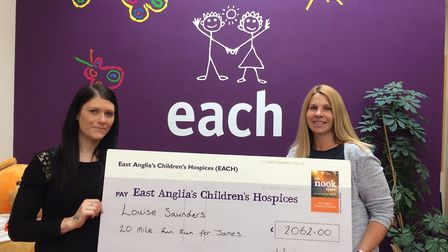Louise Saunders and Susie Ash presenting the cheque to EACH after she ran 20 miles in memory of baby