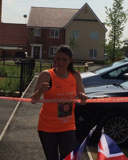 Louise Saunders after she ran 20 miles in memory of baby James Thorndyke. Photo: Susie Ash