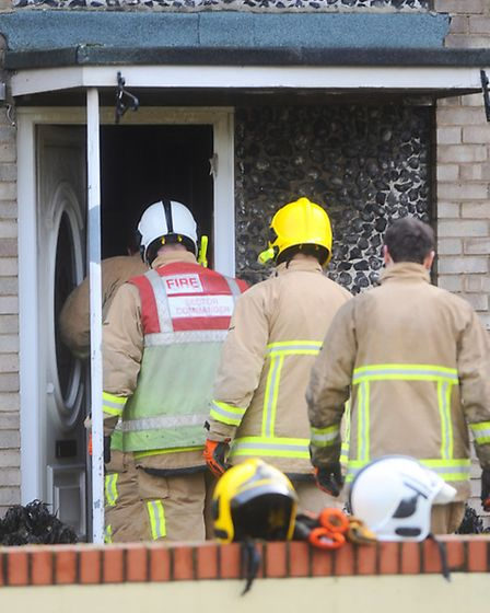 Fire fighters assess the damage at a residential property on Prigg Walk, Bury St Edmunds.