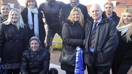 Peter Wright's family stand by the statue of the former Colchester United player that was unveiled a