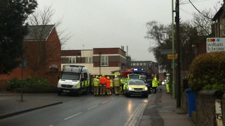 The emergency services at the scene of a collision in Girling Street, Sudbury, where a man was invol