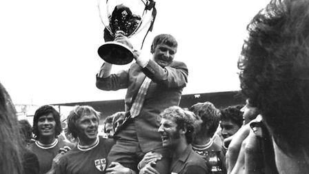 Dick Graham, Charles Chapman's favourite U's manager, is carried aloft by his players, holding the W