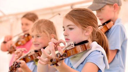 Children from Hempnall and Shelton with Hardwick Primary Schools hold a music festival on the school