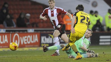 Kenny McEvoy, one of 42 players by the Us this season, has a late chance against Sheffield United in