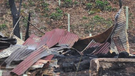 Aftermath of a barn fire in Holton.