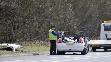 A tow truck driver prepares to place a vehicle, that was involved in a crash on the A133 between Col