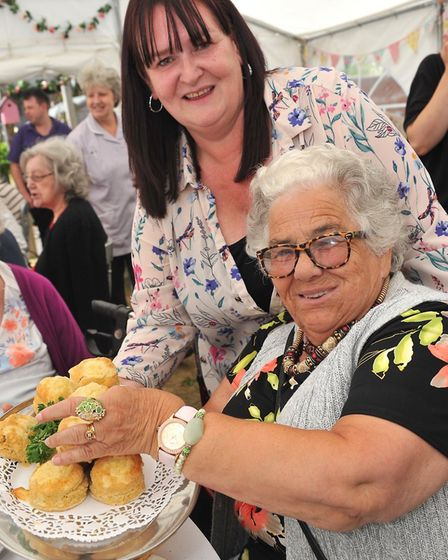 Care UK's Maria Santos with residents Judith Phillips Photo: Hartismere Place care home