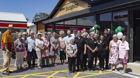 Residents and staff join owners the Lawrence family to celebrate the completion of the complete rebu