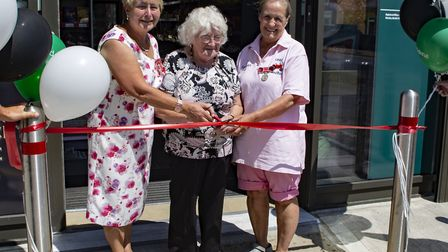 Marge Coleman (centre) with Carol Wiles MBE (left) and Annie Chapmen (right) cuts the tape at the re