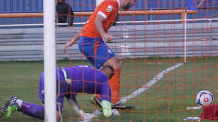 Matt Paine makes sure the ball ends up in the Torquay net.