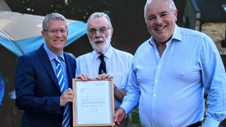 Councillor Christopher Kemp was presented with the letter by Andrew Rosindale MP and Richard Bacon M