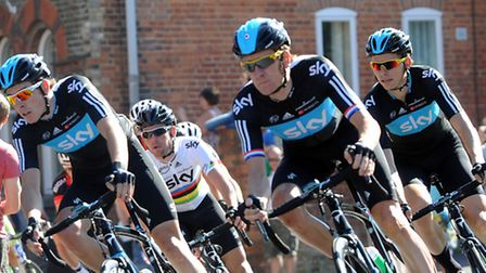 The Tour of Britain cyclists fly through Leiston High Street during a previous event