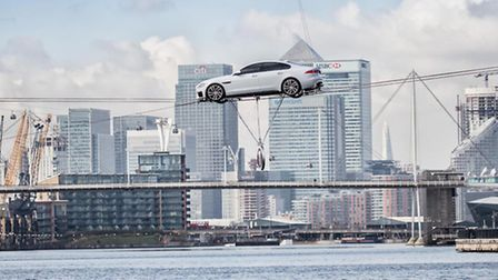 Jaguar revealed its lighter XF with a �high-wire� water crossing in London.