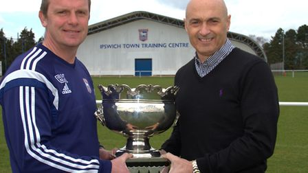 Ipswich Town academy staff Bryan Klug (left) and Simon Milton with The Hospital Cup, which is to be